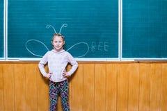 Muchacha en el consejo escolar con las alas Fotografía de archivo