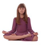 Muchacha en el fondo blanco meditating Fotos de archivo