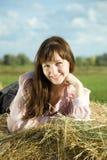 Muchacha en el heno en verano Imagen de archivo libre de regalías