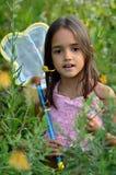 Muchacha en el jardín Fotos de archivo libres de regalías