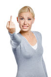 Muchacha que muestra gesto obsceno Fotografía de archivo libre de regalías