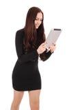 Muchacha en el movimiento que mira la tableta Fotografía de archivo