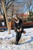 Muchacha en el oscilación en invierno Imagen de archivo
