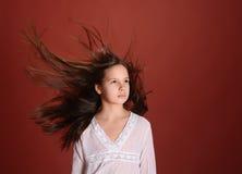 Muchacha en el pelo del vuelo del viento Imagenes de archivo