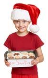 Muchacha en el sombrero con las galletas - concepto de santa de la Navidad de las vacaciones de invierno Fotografía de archivo libre de regalías