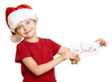 Muchacha en el sombrero con las galletas - concepto de santa de la Navidad de las vacaciones de invierno Fotos de archivo libres de regalías