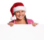 Muchacha en el sombrero de Santa Fotografía de archivo