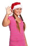 Muchacha en el sombrero de Santa Imagen de archivo libre de regalías