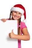 Muchacha en el sombrero de Santa Fotografía de archivo libre de regalías