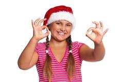 Muchacha en el sombrero de Santa Foto de archivo