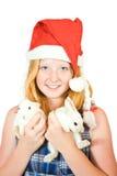 Muchacha en el sombrero de santa con los conejos Imágenes de archivo libres de regalías