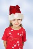 Muchacha en el sombrero de santa rojo Fotografía de archivo libre de regalías