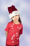 Muchacha en el sombrero de santa rojo Fotografía de archivo