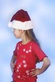 Muchacha en el sombrero de santa rojo Fotos de archivo libres de regalías