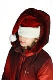 Muchacha en el sombrero de santa rojo Imagenes de archivo