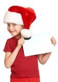 Muchacha en el sombrero rojo de santa con la PC de la tableta en blanco aislada Fotografía de archivo