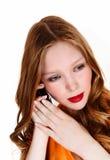 Muchacha en el teléfono celular. Imagenes de archivo