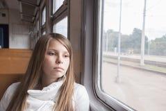 Muchacha en el tren Fotografía de archivo libre de regalías