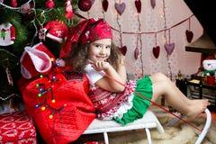 Muchacha en el trineo Fotografía de archivo libre de regalías