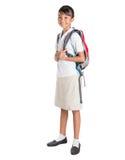 Muchacha en el uniforme escolar y la mochila I Imágenes de archivo libres de regalías