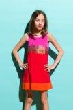 Muchacha en el vestido colorido que mira lejos Imágenes de archivo libres de regalías