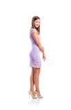 Muchacha en el vestido púrpura del cordón, talones, tiro del estudio, aislado Fotografía de archivo libre de regalías