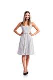 Muchacha en el vestido punteado blanco y negro, talones, tiro del estudio, isolat Fotos de archivo libres de regalías