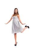 Muchacha en el vestido punteado blanco y negro, talones, tiro del estudio, isolat Imagen de archivo libre de regalías