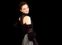 Muchacha en el vestido victoriano oscuro que mira al revés fotografía de archivo