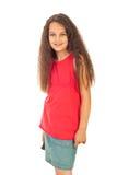 Muchacha en falda en blanco de la camiseta y del dril de algodón Fotos de archivo