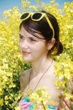Muchacha en flores Fotografía de archivo libre de regalías