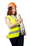 Muchacha en guardapolvos y un casco con las latas del metal en sus manos Aislado Fotos de archivo libres de regalías