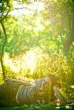 Muchacha en jardín Foto de archivo libre de regalías