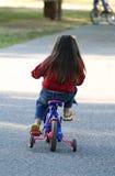 Muchacha en la bici Imágenes de archivo libres de regalías