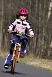 Muchacha en la bici Imagen de archivo libre de regalías