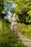 Muchacha en la bici Foto de archivo libre de regalías
