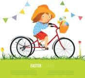 Muchacha en la bici con la cesta llena de huevos para Pascua Foto de archivo libre de regalías
