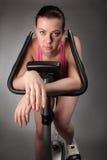Muchacha en la bicicleta Foto de archivo libre de regalías