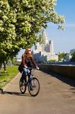 Muchacha en la bicicleta Fotos de archivo libres de regalías