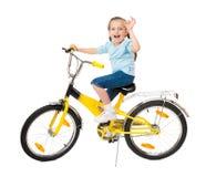 Muchacha en la bicicleta en blanco Fotos de archivo