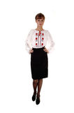 Muchacha en la blusa y la falda blancas. Foto de archivo libre de regalías
