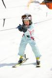 Muchacha en la elevación de esquí Imagen de archivo