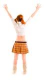 Muchacha en la falda que se coloca de nuevo a cámara Imágenes de archivo libres de regalías