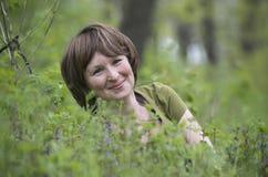 Muchacha en la hierba Foto de archivo libre de regalías
