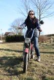 Muchacha en la moto Fotos de archivo libres de regalías