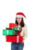 Muchacha en la Navidad con las cajas de regalo Imagen de archivo libre de regalías
