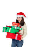 Muchacha en la Navidad con las cajas de regalo Imagen de archivo