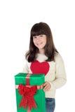 Muchacha en la Navidad con las cajas de regalo Fotos de archivo libres de regalías