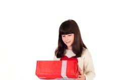 Muchacha en la Navidad con las cajas de regalo Fotografía de archivo libre de regalías