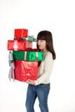 Muchacha en la Navidad con las cajas de regalo Fotografía de archivo